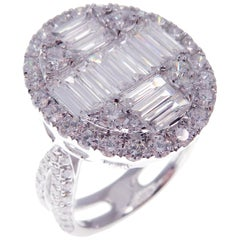 18 Karat White Gold Diamond Sleek Baguette Oval Fancy Ring