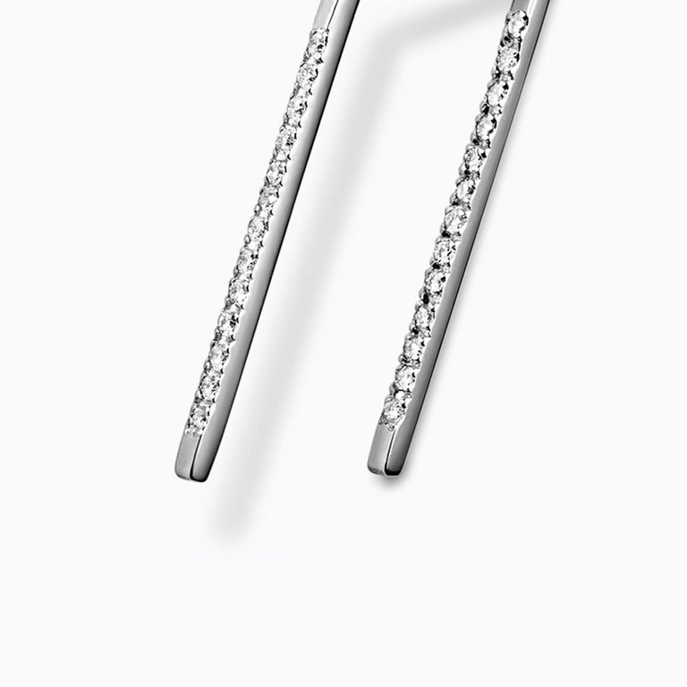 This earring features micro diamonds in a pavé setting along two lines. The micro diamonds are small enough that it can go through the pierced hole. This can be worn without an earring back.  Diamonds: 0.7mm x 25 Post length: 15.5mm, 7.5mm,