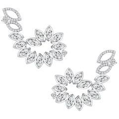 18 Karat White Gold Diamond Swirl Earrings