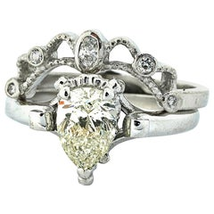 18 Karat White Gold Solitaire Diamond Wedding Ring and Diamond Keeper Ring Set