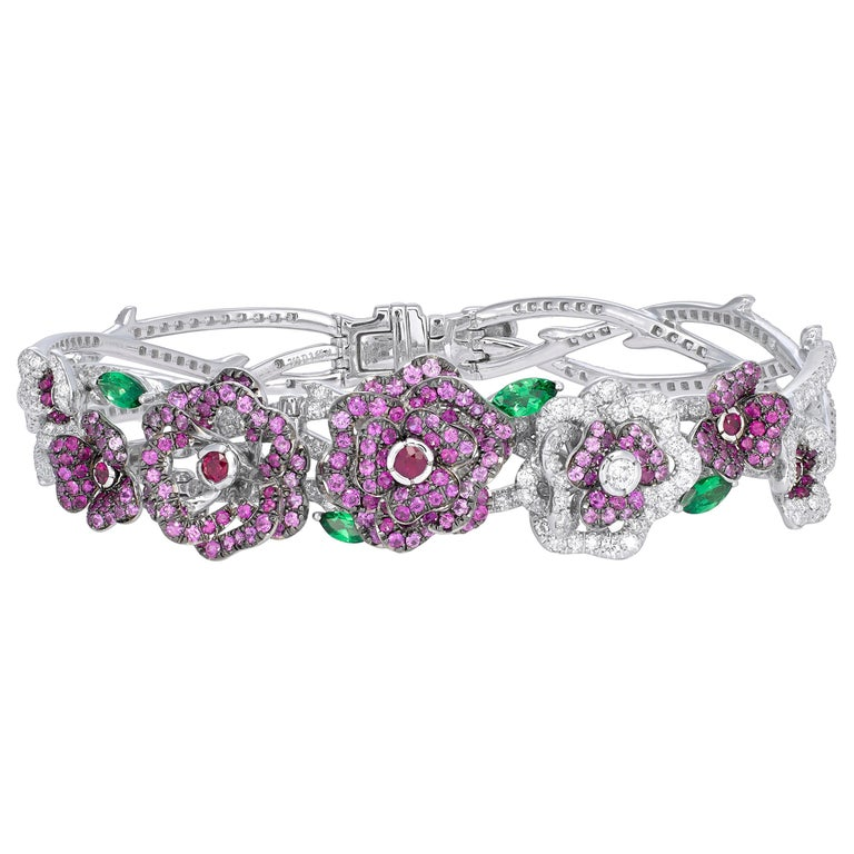 Round Cut 18 Karat White Gold, Diamonds, Pink Sapphires and Rubies Earrings and Bracelet For Sale