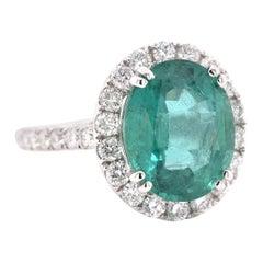 18 Karat White Gold Emerald and Diamond Halo Ring