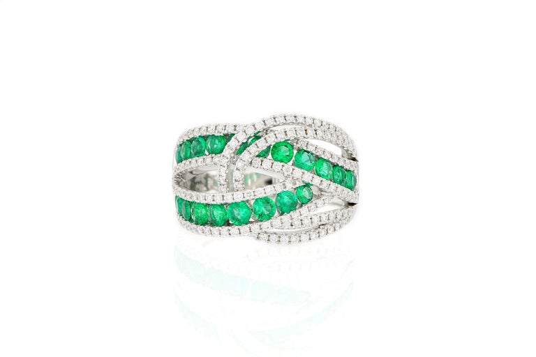 This dramatic and fun cocktail ring , set with bright green emeralds from Columbia,  totaling 1.16 carats, decorated with brilliant-cut diamonds weighing 0.73 carats, mounted in 18 karat white gold. O'Che 1867 is renowned for its high jewellery