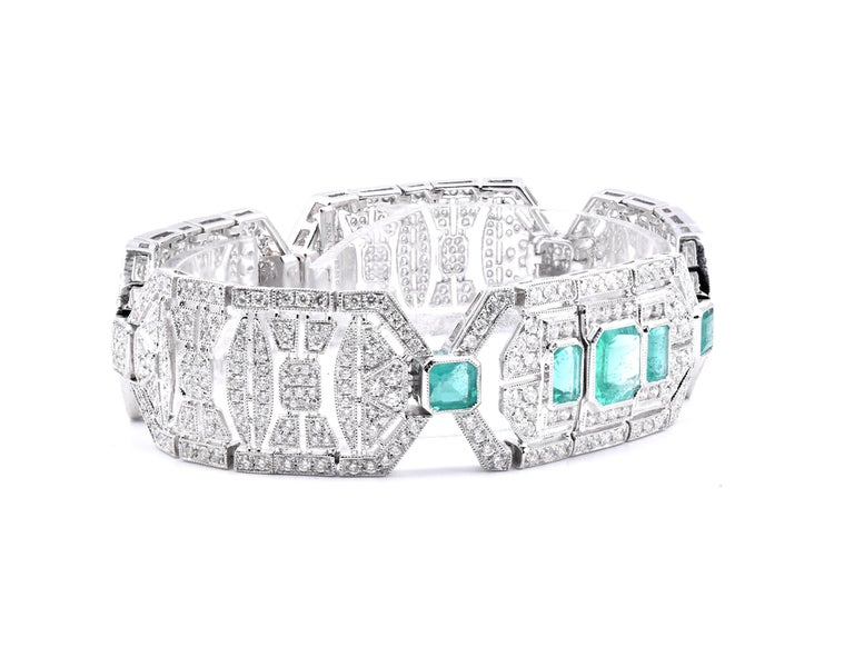 Material: 18K white gold Diamonds:  651 round cut = 6.16cttw Color: G Clarity: VS Emeralds: 5 multi cut = 3.53cttw Color: Medium Green Dimensions: bracelet will fit up to a 7-inch wrist and measures 18.75mm in width  Weight: 45.90 grams