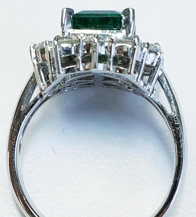 18k White Gold Emerald Cut Emerald and Diamond Ring 1.87 carats of Emeralds 1.30 carats of Diamonds Emerald cut 18k white gold