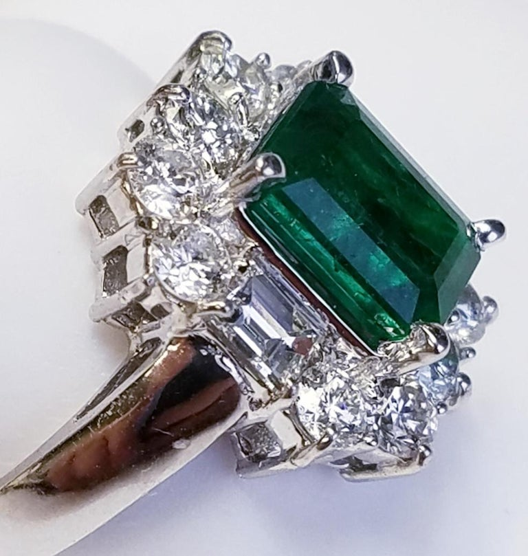 Women's or Men's 18 Karat White Gold Emerald Cut Emerald and Diamond Ring For Sale