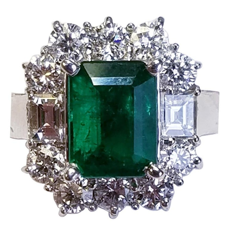 18 Karat White Gold Emerald Cut Emerald and Diamond Ring For Sale