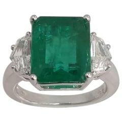 18 Karat White Gold Emerald Cut Emerald and Diamond Three-Stone Ring
