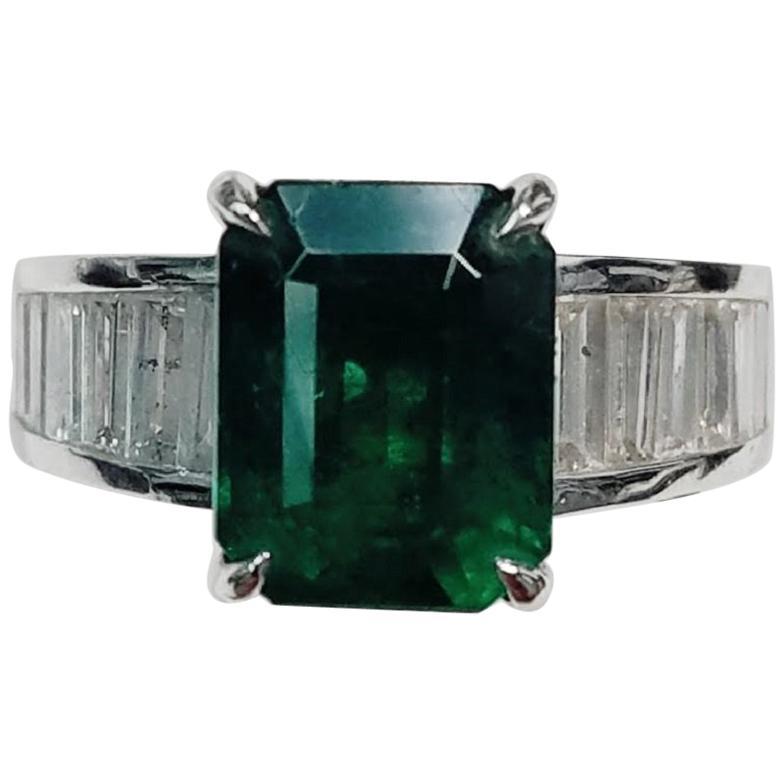 18 Karat White Gold Emerald Cut Emerald and Genuine Diamond Ring