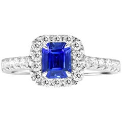 18 Karat White Gold Emerald Cut Sapphire Halo Diamond Engagement Ring