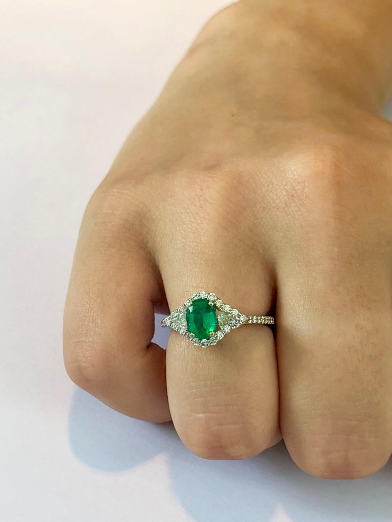 Oval Cut 18 Karat White Gold Emerald Diamond Cocktail Ring  For Sale
