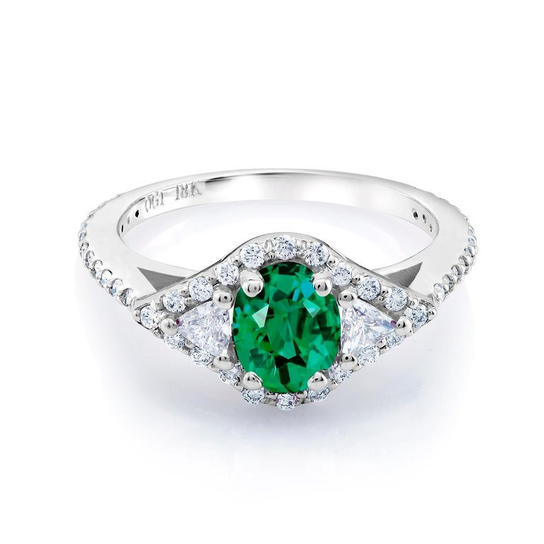 18 karat white gold emerald and diamond cocktail ring  Ring finger size 6.5  Diamond carat weight 0.45  Trillion diamond carat weight 0.25  Emerald carat total weight 0.98 Diamond quality G VS One of a kind ring  New ring  Ring can be resized  Our