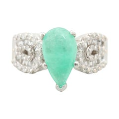 18 Karat White Gold Emerald Pear and Diamond Round Baguette Ring
