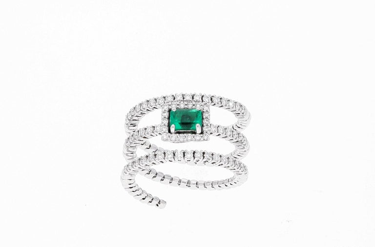 18 karat white gold extendable ring with diamonds lines and one emerald with diamonds around  Total diamonds weight: 0.62 carat One emerald weight: 0.45 carat Total weight: 7 grams Ring size: Size IT 15, USA 7-1/4, FR 54 Approximate size as the ring