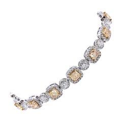18 Karat White Gold Fancy Yellow and White Diamond Tennis Bracelet