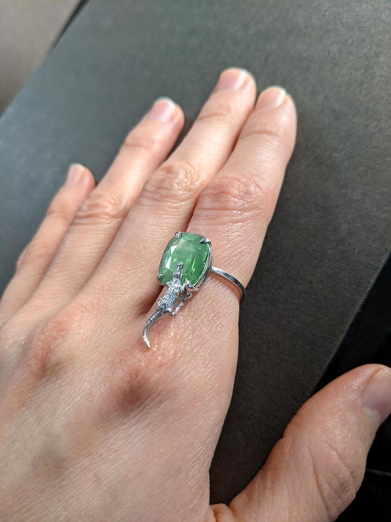 This 18 karat white gold Mesopotamian fashion ring is encrusted with 3.48 carats natural cushion cut emerald, cold tone, 10.5x9 mm.   You can order this piece in white, rose or yellow gold, with spinel, sapphire, emerald, tourmaline or the other