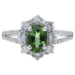 18 Karat White Gold Green Tourmaline and Diamond Split Shank Halo Cocktail Ring