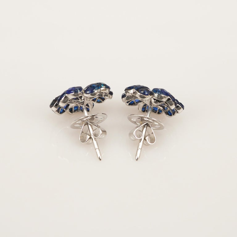 A lovely sapphire stud earrings that you can use as everyday.We use the top quality Sapphire for our invisible setting.It is sweet blue and very sparking. The invisible is a highly technique .We set the stone in perfection as we are professional in