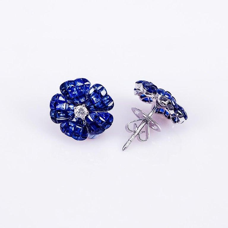 Modern 18 Karat White Gold Invisible Sapphire Flower Stud Earrings For Sale