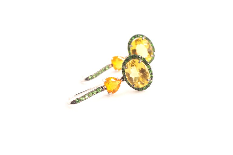 Freena Eardrops A pair of convertible eardrops set in eighteen-karat white gold.  Each eardrop begins with a tsavorite garnet-encrusted earwire, suspending a heart shaped fire opal and a yellow beryl surrounded entirely by tsavorite garnets.  The