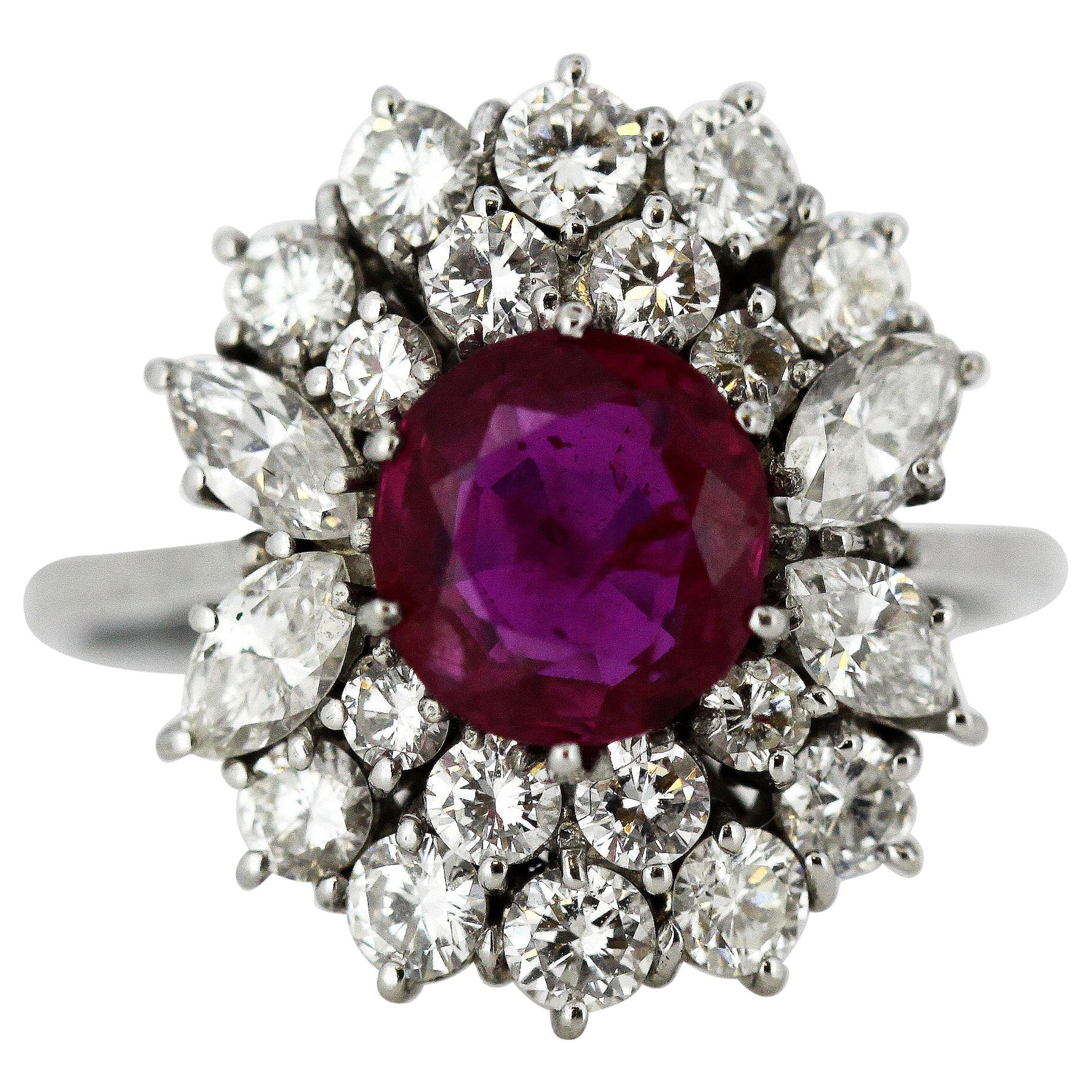 18 Karat White Gold Ladies Cluster Ring with a Central Ruby and Diamonds