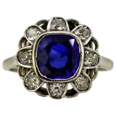 18 Karat White Gold Ladies Cluster Ring with Natural Blue Sapphire and Diamonds