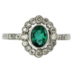 18 Karat White Gold Ladies Cluster Ring with Natural Emerald and Diamonds