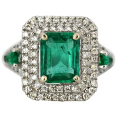18 Karat White Gold Ladies Ring with Natural Emerald and Diamonds, 1980s