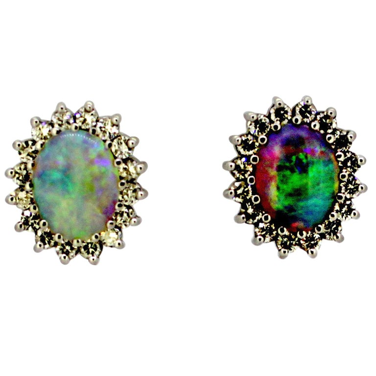18 Karat White Gold Ladies Stud Earrings with Opals and Diamonds, circa 1990s For Sale
