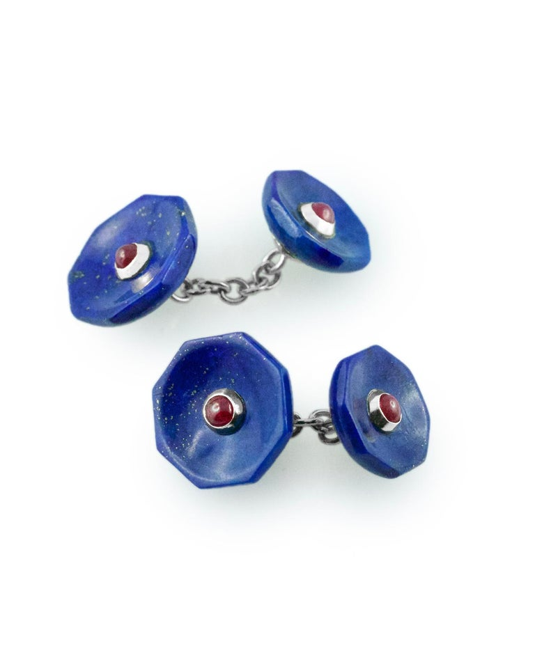 These cufflinks are both classic and bold and feature an octagonal front face and an identically shaped toggle, both made of lapis lazuli with a central decoration made of cabochon rubies that creates a striking color combination. The stones are
