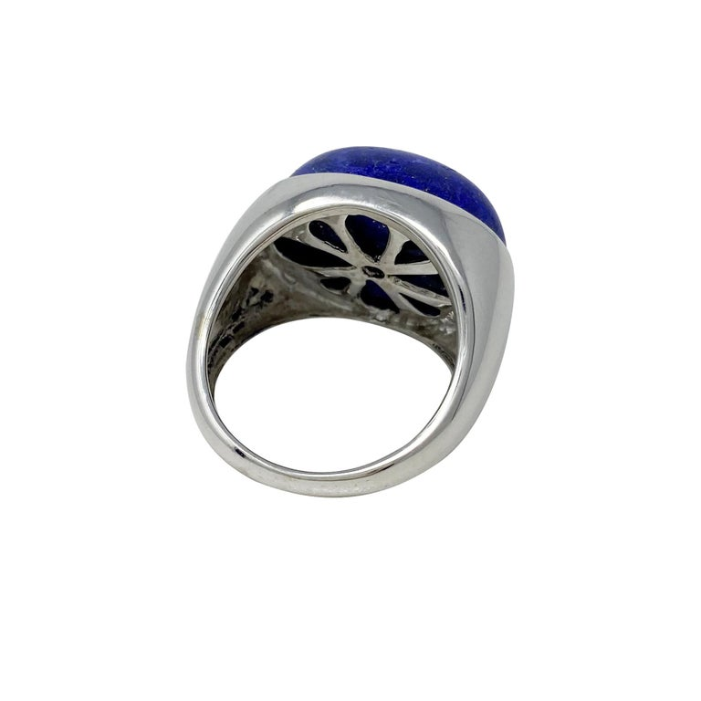 The oval-shaped, cabochon-cut lapis lazuli is a lovely shade of blue and the 18 karat white gold mounting and the yellow pyrite in the stone go beautifully together!  Size 9 1/4