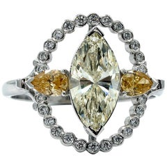 18 Karat White Gold Marquise Yellow Diamond Ring