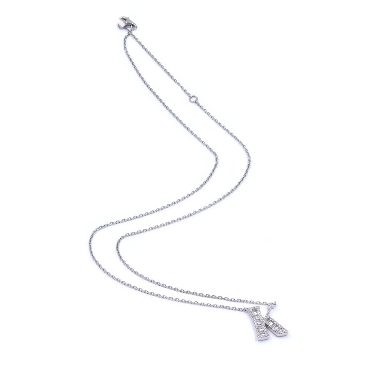 Designer: custom Material: 18K white gold Diamonds: 90 round and baguette cut = .29cttw Color: H Clarity: SI1 Dimensions: necklace measures 20-inches Weight: 4.08 grams