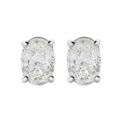 18 Karat White Gold Mye Oval Diamond Stud Earrings