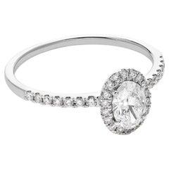 18 Karat White Gold Mye Oval Halo Diamond Ring