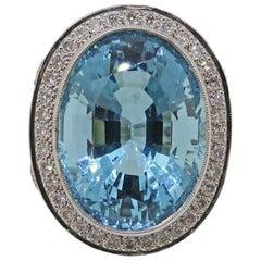 18 Karat White Gold Oval Aquamarine 19.33ct and Diamond Cluster Ring