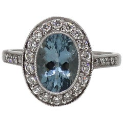 18 Karat White Gold Oval Aquamarine and Diamond Art Deco Style Cluster Ring