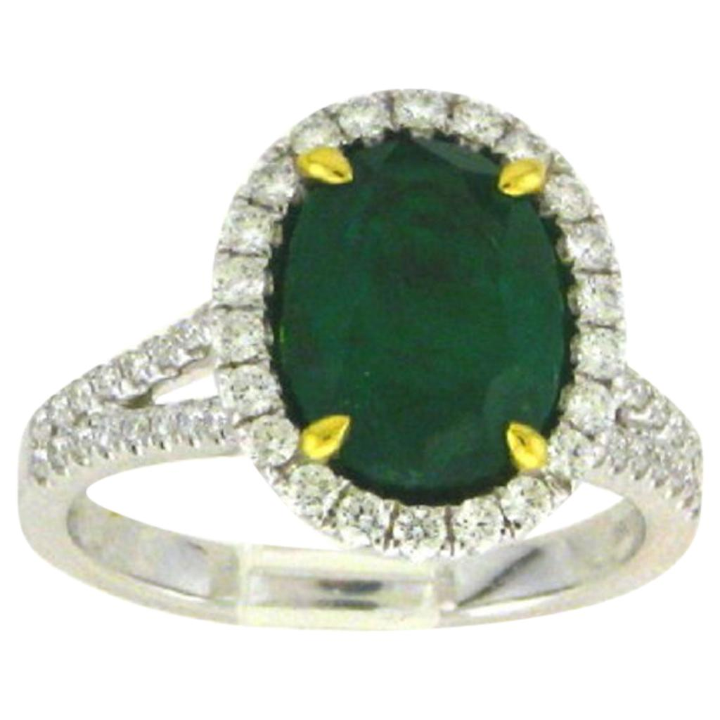 18 Karat White Gold Oval Cut Emerald and Diamond Ring