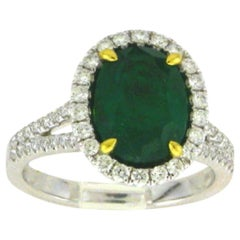 18 Karat White Gold Oval Cut Emerald and Diamond Ring