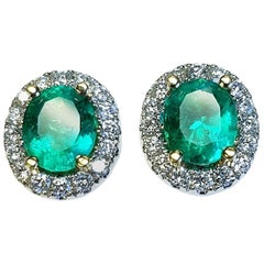 18 Karat White Gold Oval Cut Natural Colombian Emerald and Diamond Earrings