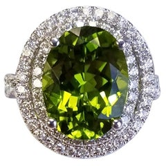 18 Karat White Gold Oval Cut Peridot and Diamond Ring