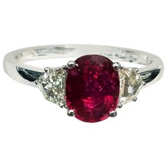 18 Karat White Gold Oval Cut Ruby and Genuine Diamond Ring