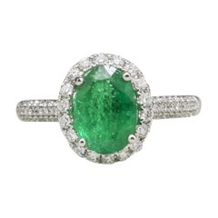 18 Karat White Gold Oval Emerald and Diamond Fashion Ring
