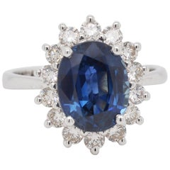 18 Karat White Gold Oval Natural Blue Sapphire Diamond Engagement Ring