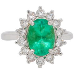 18 Karat White Gold Oval Natural Colombian Emerald Diamond Bridal Ring