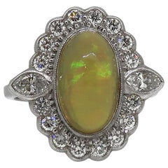 18 Karat White Gold Oval Opal and Diamond Art Deco Style Cluster Ring