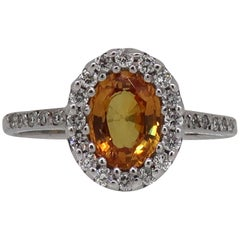 18 Karat White Gold Oval Yellow Sapphire and Diamond Halo Cluster Ring