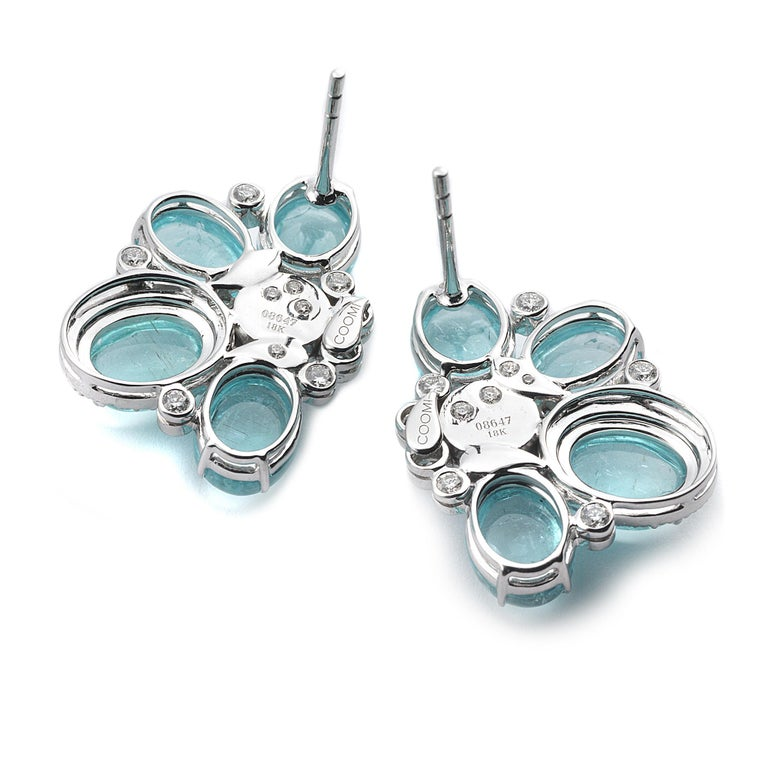 Trinity collection stud earrings set in 18K white gold with 14.15cts paraiba and 1.28cts diamond.