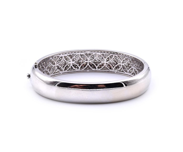 Designer: custom designed Material: 18k white gold Diamonds: round brilliant cut =9.81cttw Color: G Clarity: VS2 Dimensions: bracelet will fit a 6 ½ inch wrist and it is 19.63mm wide Weight: 47.00 grams