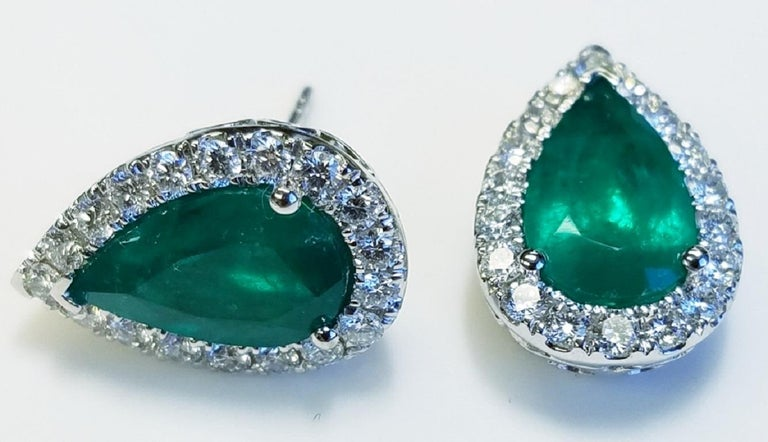 18k White Gold Pear Shape Colombian Emerald and Diamond Earrings 4.80 carats of Colombian Emeralds 1.19 carats of Diamonds Pear Shape  18k white gold